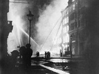 Burning buildings in Queen Victoria Street, EC4, after the last and heaviest major raid mounted on the night of 10-11 May 1941.