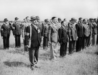 Local Defence Volunteers lined up, in July 1940, in plain clothes sporting LDV armbands.© IWM