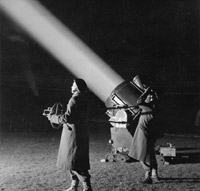 ATS officers operate a searchlight