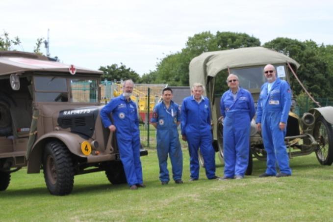 Volunteers team with historical vehicles