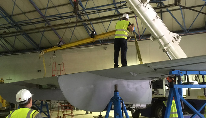 The re-assembly operation gets underway - here the wing has just been lowered down onto its tressles