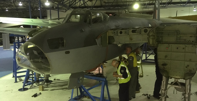 de Havilland Museum volunteers Roy Thomas (left) and Gerry Mears refitting the port side panel to the fuselage