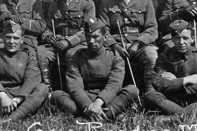 The Staff, School of Technical Training (Men), Royal Flying Corps, Reading, May 1917 (X003-2696)  None of the officers or men in the photograph is named. The Black corporal (inset) is probably a ground instructor.