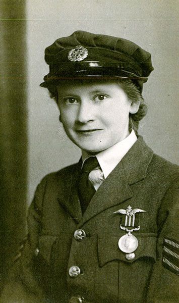 Acting Corporal Avis Joan Hearn wearing her Military Medal. © RAF Museum X004-8476/001