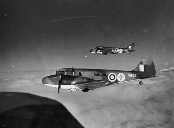 Airspeed Oxford ambulances P8833 and P8832 of No. 24 Squadron in formation over Hendon. © RAF Museum PC72/31/22