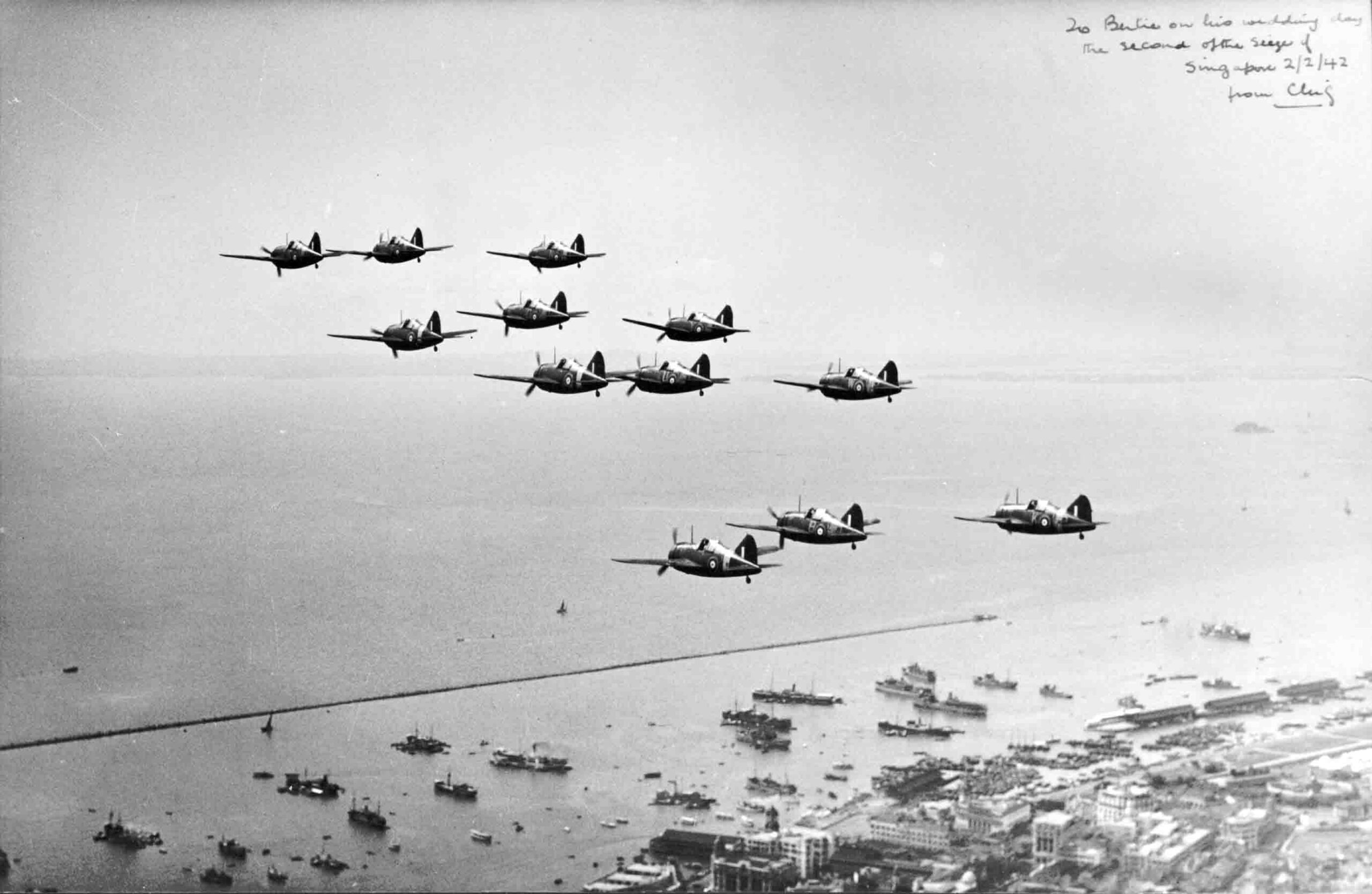 P007759 Brewster Buffalo's Mk. IIs of No. 243 Squadron, flying over Singapore, 2 February 1942