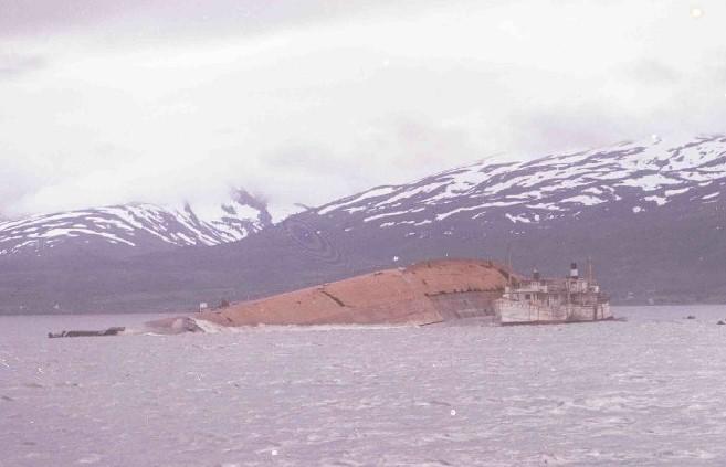 Tirpitz capsized with salvage vessel alongside 1945. PO14993
