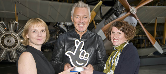 Karen Whitting Director Public Programmes (left) with Maggie Appleton (right) receiving the HLF Award for Best Heritage Project 2015 from Martin Kemp