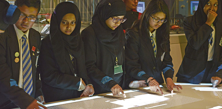 Students interacting with the debate table in H1