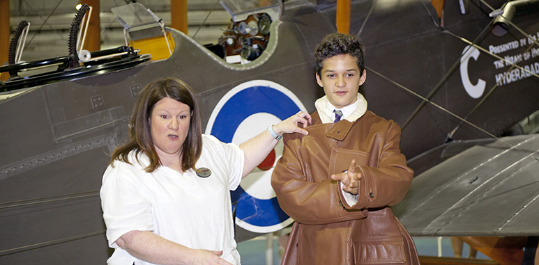 Student dressed in First World War flying coat