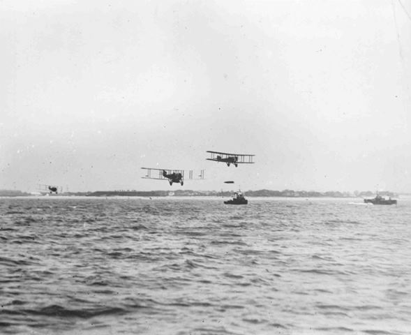 P000392: Sopwith Cuckoos of 186 Squadron practice torpedo dropping, probably in 1919, in a scene similar to that which would have occurred if the attack on the High Seas Fleet had gone ahead.