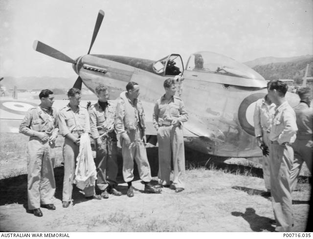 Pilots of 77 Squadron RAAF standing by a P-51 Mustang at Taegu, Korea, 1950 (AWM P00716.035)