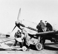 At the end of September an instruction was issued within Luftflotte 2 that each Jagdgeshwader was to fit one Gruppe with bomb racks. These fighter-bombers came over the coast at high altitude and Fighter Command found them difficult to intercept. Although Dowding had no way of knowing this instruction had been given his authorisation of the formation of high flying Spotting Flights earlier in September was now vindicated. Here German ground crew bomb up a Bf 109E (Jagdbomber) Jabo.