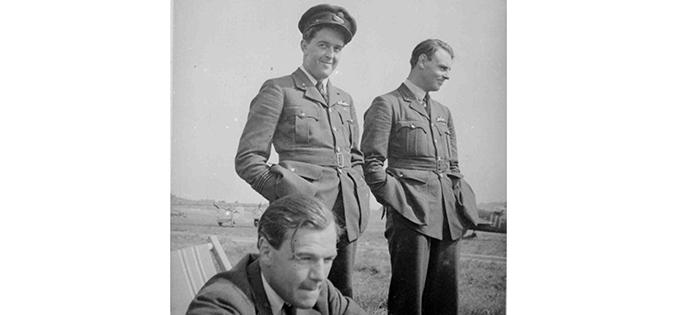Fg Off John William Max Aitken of 601 Squadron in a deckchair with Flt Lt Michael F. Peacock and Plt Off Carl Raymond Davis behind, RAF Hendon, 1939