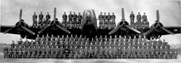 Group photograph of 158 Squadron in front and on top of a Handley Page Halifax Mk. III (P013472)