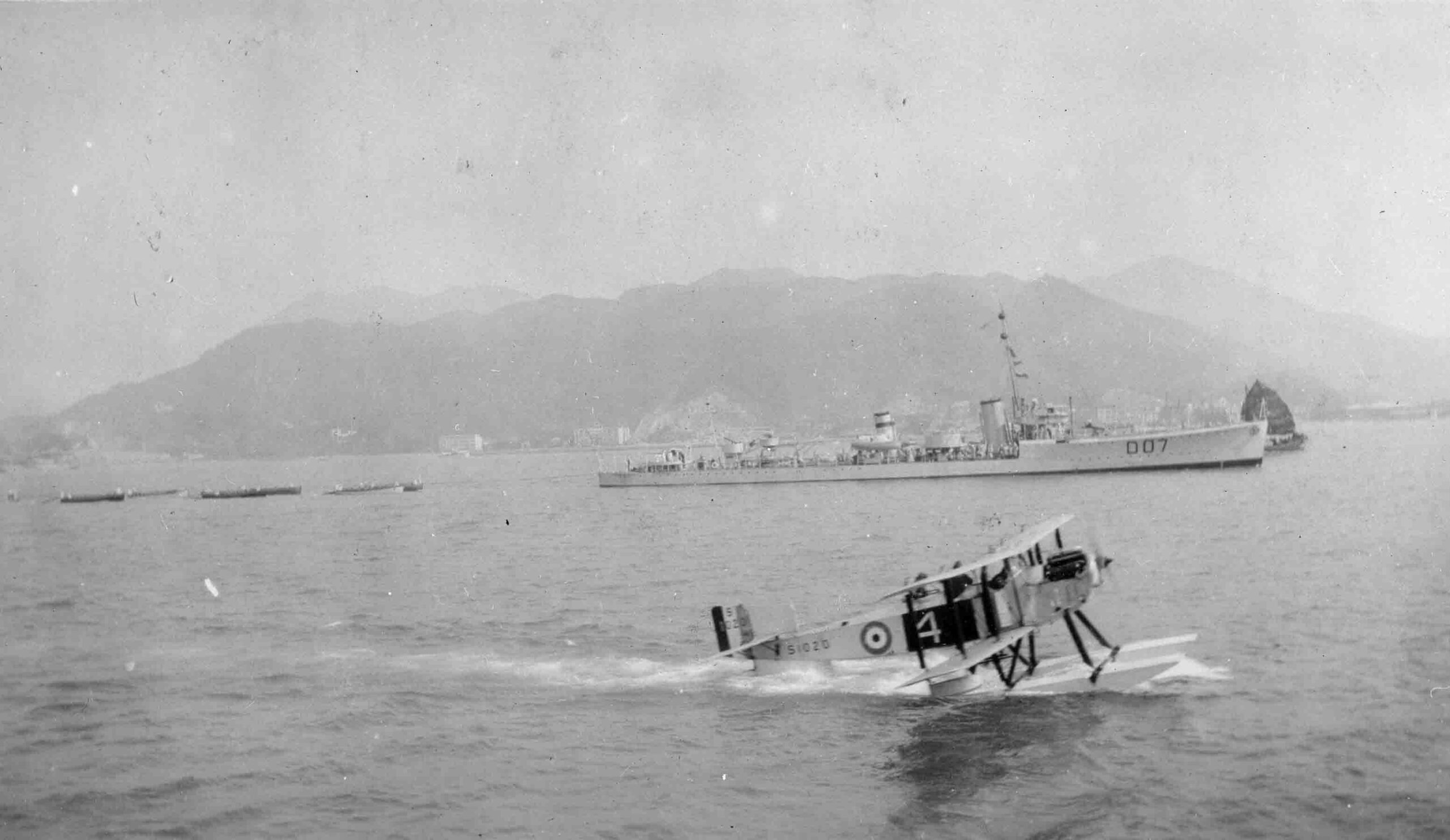 Fairey IIID taxying on water at Hong Kong in front of County Class destoyer, circa 1925 (P022428)