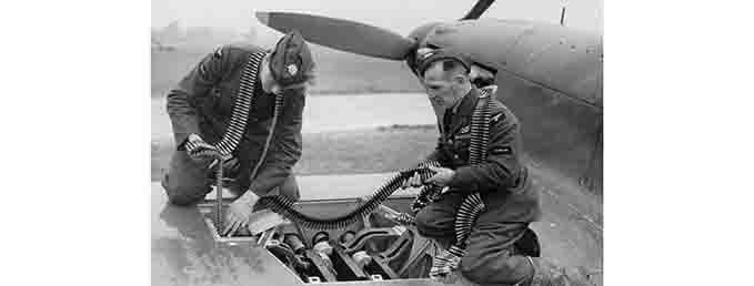 Two armourers re-arming a 504 Squadron Hurricane, RAF Hendon, 1940