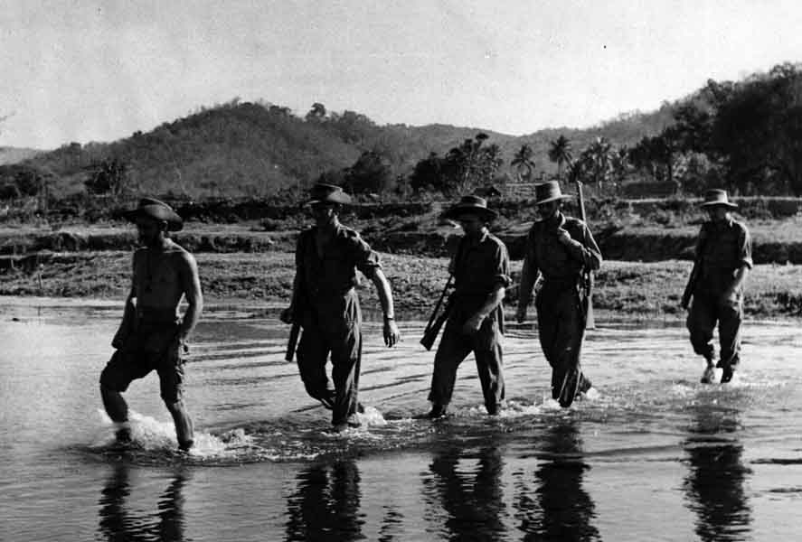 PC71_19a_1693 Chindits of the Second Wingate Expedition wading through a stream on patrol, Burma, 1944