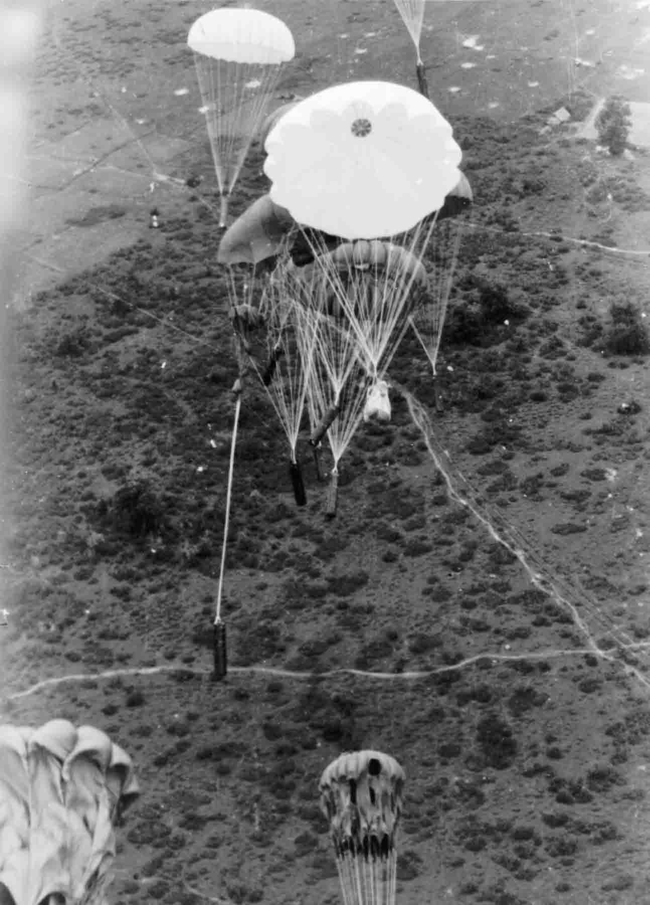 PC71_19_1886 Supply containers going down in Indo-China, 1945
