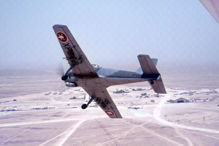 A Hunting Percival Piston Provost banking over Salalah