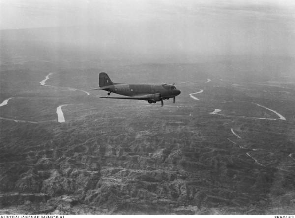 An RAF Douglas Dakota transport aircraft in flight over the Burmese jungle (AWM SEA 0152)