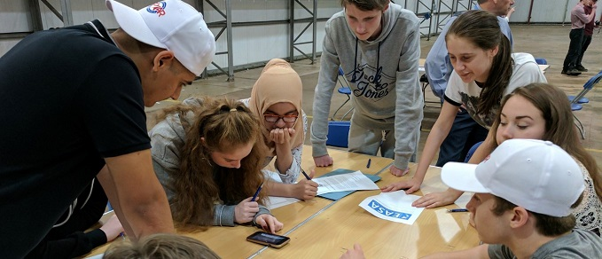 Students from last year's pilot programme working as a team to solve a real life problem