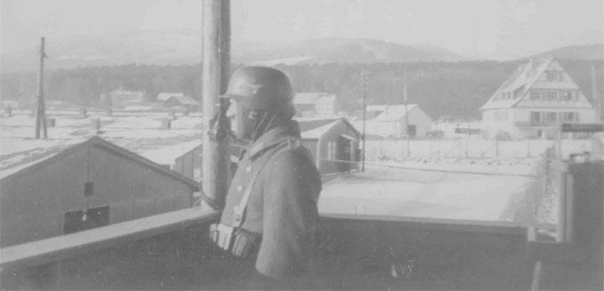 Unknown German Guard in Watchtower overlooking a German Prisoner of War Camp