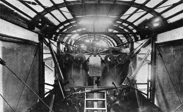 The rear gun positions of a Felixstowe F.3 with their Lewis guns and ammunition drums.  The gun-layer stood on the small step ladder when manning the dorsal gun.  (RAFM ref X003-2602/6837)
