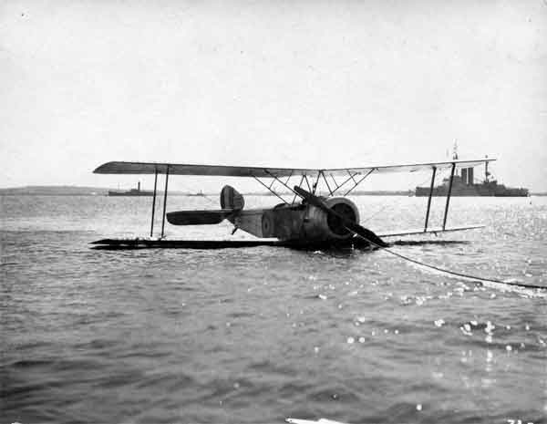 X003-2602/13928: Sopwith 1½ Strutter, serial 9377, RNAS, seen after a trial ditching and with flotation gear deployed, probably in Sheerness Harbour, 1917