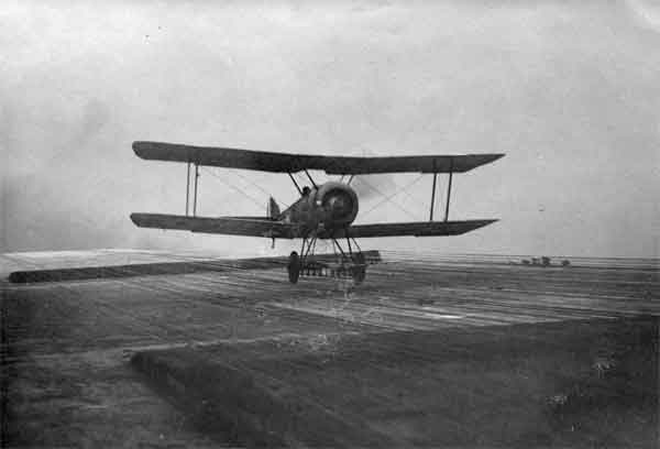 X003-2602/14346: Sopwith Pup, landing on HMS Argus, October 1918.  This was photographed when trials were being made with longitudinal cables for arresting aircraft.  The idea was short-lived.