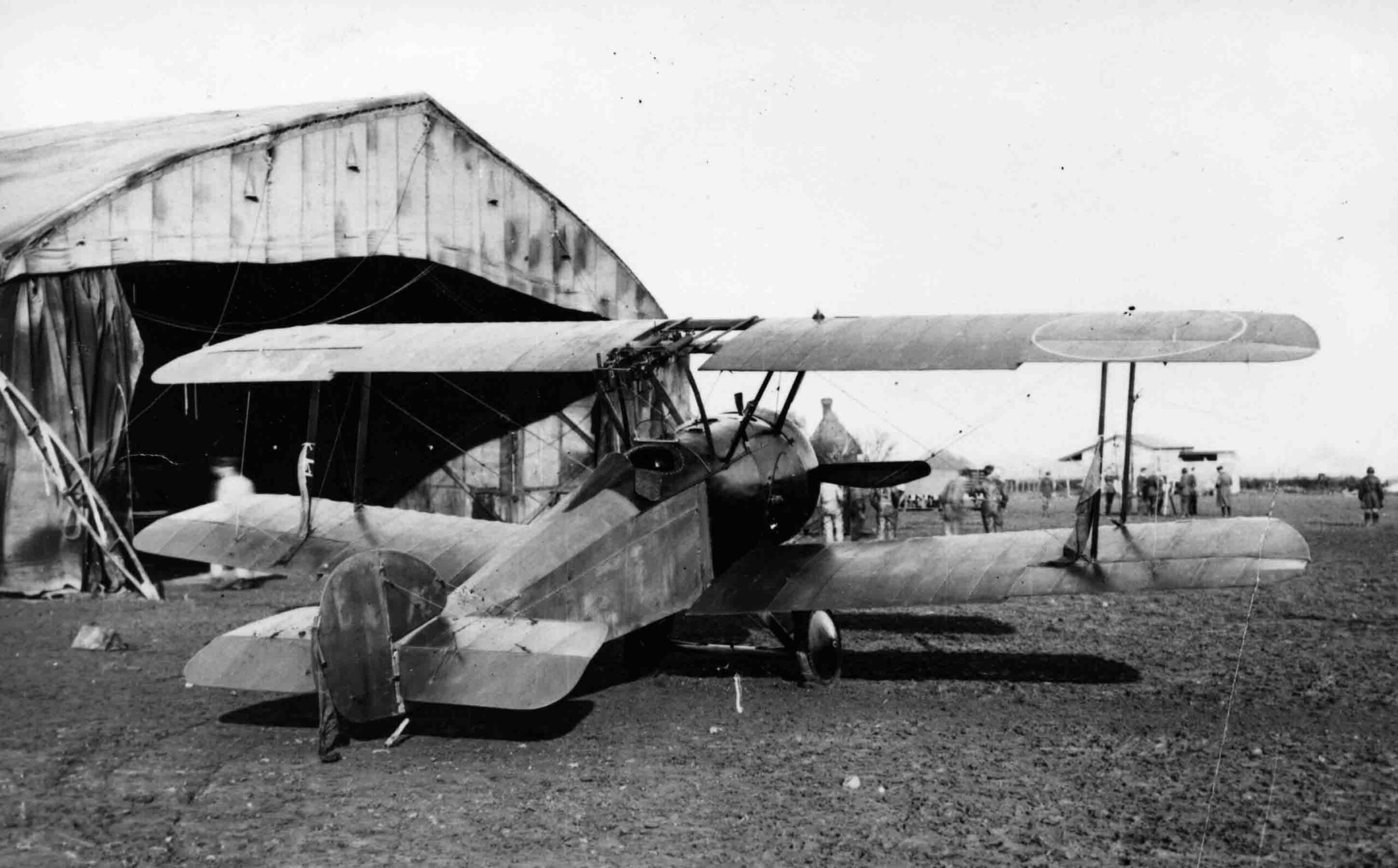 X003-2602/15426: Sopwith F.1/3 Comic-Type Camel.  This 50 Squadron, RAF, aircraft was based at Bekesbourne when photographed in 1918. Home Defence roundels were applied to the upper wing, while the fuselage roundels and rudder stripes were obliterated.  Streamers were attached to the rear interplane struts and rudder.