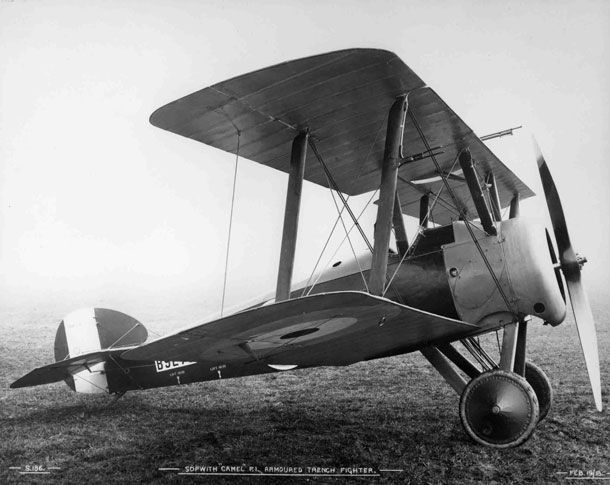 X003-2602/15727: Boulton and Paul-built Sopwith T.F.1 Camel, serial B9278, at Brooklands in February 1918.  The Lewis gun fitted to the upper-wing centre-section and the two downward-firing Lewis guns, fitted between the undercarriage legs, can be seen.