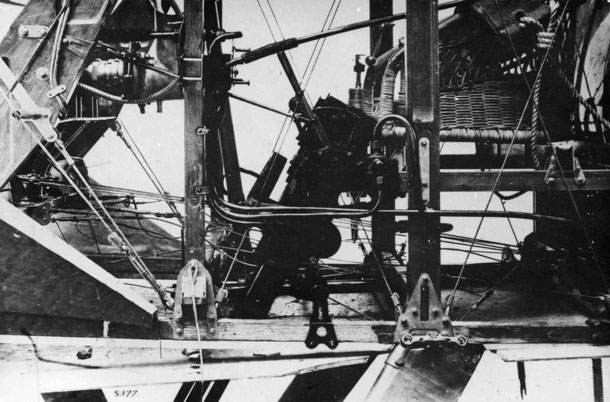 X003-2602/15732: A port side close-up of the cockpit interior and Lewis guns of the TF.1 Camel, 1918.