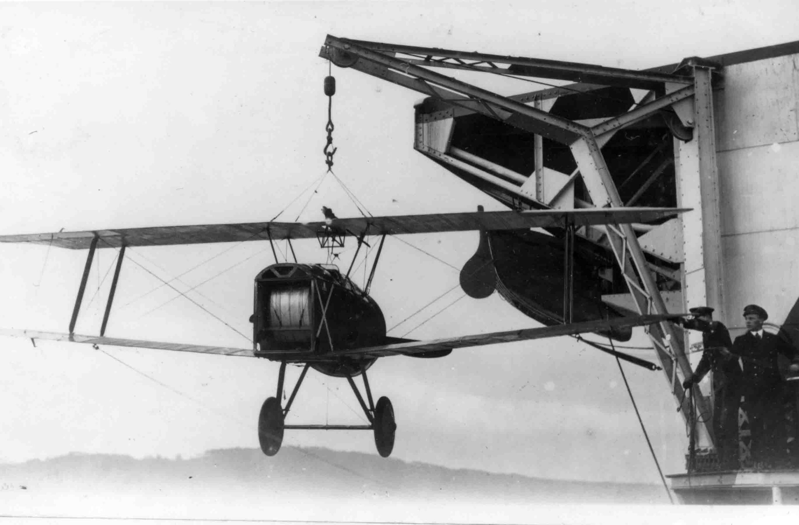 """X003-2602/15774: Sopwith 2F.1 Camel, serial N6602.  This aircraft, seen during transfer to HMS Furious on 5 April 1918, shows the fuselage """"broken"""" in two for transport and storage."""