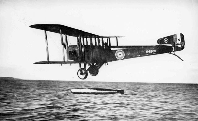 X003-2602/15910: Blackburn-built Sopwith Cuckoo, serial N6966, dropping a torpedo, 1918.  Both this aircraft and serial N6950 appear to be finished in the standard scheme of PC10 fabric covering with Battleship Grey metal cowling panels.