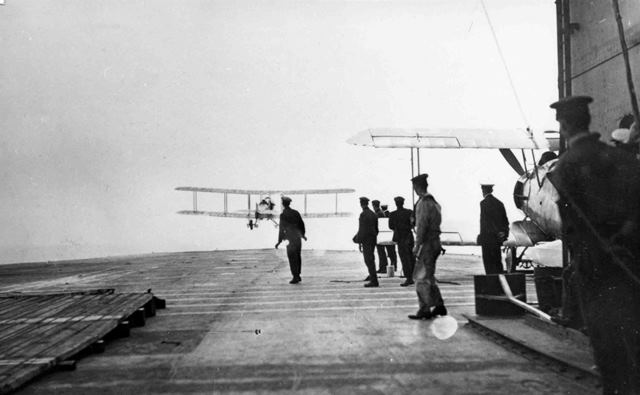 X003-2602/15913: A Sopwith Cuckoo taking off, probably from HMS Eagle, during the ship's trials in 1920.  A Parnall Panther is at right.