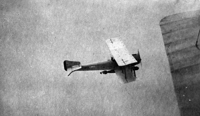 X003-2602/15920: An air-to-air view of a Sopwith Cuckoo loaded with an 18 inch torpedo.