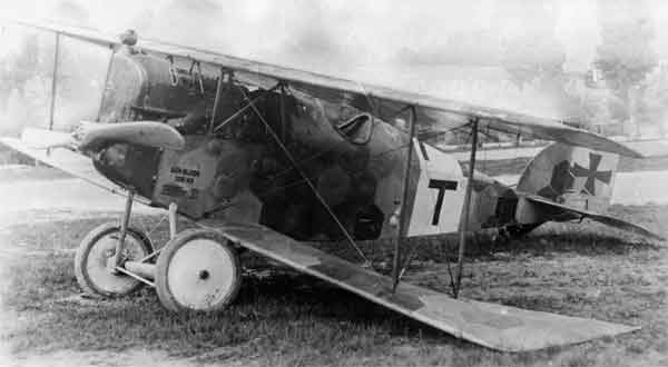 X003-2602/18670: Aviatik D.I, serial 138.43. This Series 138 aircraft, fitted with the 200hp Daimler engine, forced landed and was captured on 23 June 1918 while serving with Flik 74J.  The personal marking of Karl Thomas, (a 'T' set against a white background), was applied to the aircraft, although it was flown by Corporal August Staatz when captured.