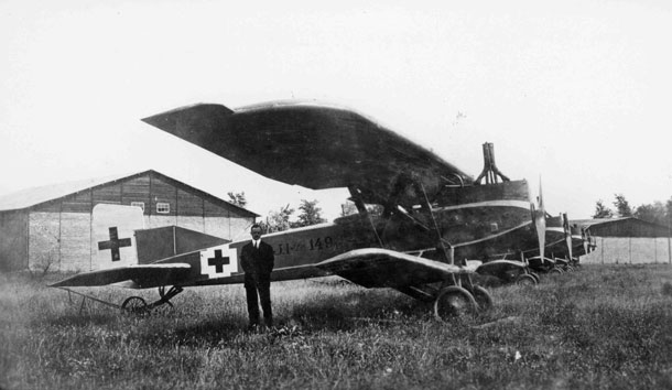 X003-2602/19935: 'The flying furniture van'.  A line of Junkers J.I aircraft, possibly photographed at the Junkers airfield at Dessau during 1918.