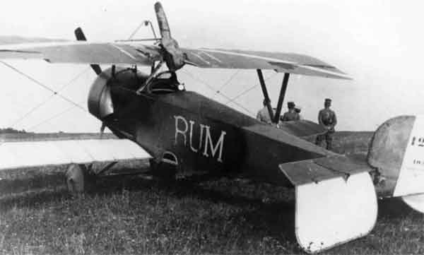 X003-2602/21806: Nieuport 11, serial N1290, (RUM), Escadrille N124, French Air Force at Behonne on the 26th or 27th August 1916. A cover has been placed over the Lewis gun. This aircraft was flown by Sgt L.D. Rumsey.