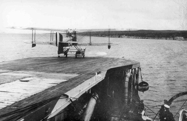 X003-2602/6228: A Fairey Campania takes off from the forward deck of HMS Campania, 1918.