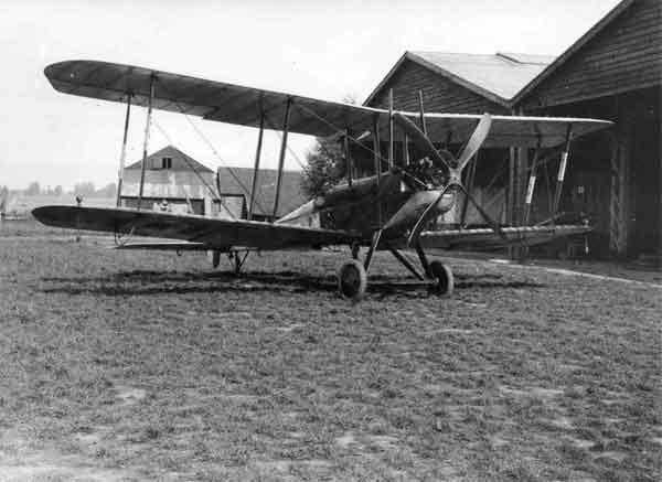 X003-2602-9663: Royal Aircraft Factory B.E.2c, serial 4112, with 2Lt Sowrey sitting in the cockpit, B Flight, 39 Squadron, RFC, Suttons Farm.  Although not Robinson's aircraft, this Bristol-built example gives a good idea of the appearance of 39 Squadron's home defence B.E.2cs.  Like Robinson's, the aircraft has a Lewis gun fitted to a Strange Mounting and navigation lights and flare brackets are attached to the lower wing.  Similarly, the forward fuselage was probably camouflaged with PC10, while the rear fuselage was finished in clear-doped linen.  The lower wing upper surfaces were possibly likewise camouflaged with a dark finish.  The protective taping on the outer interplane struts reveal that the aircraft was once fitted with the maligned Le Prieur rockets.  This aircraft was used by Sowrey to destroy L32 on the night of 24 September 1916.