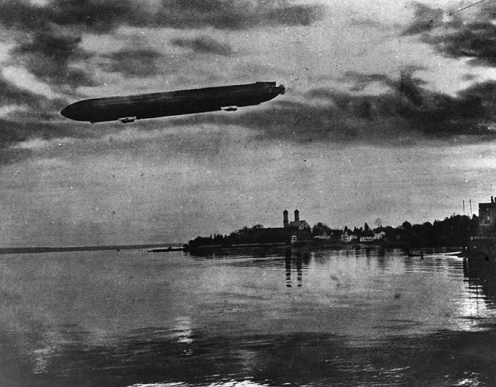 Zeppelin Airship in Flight over a lake