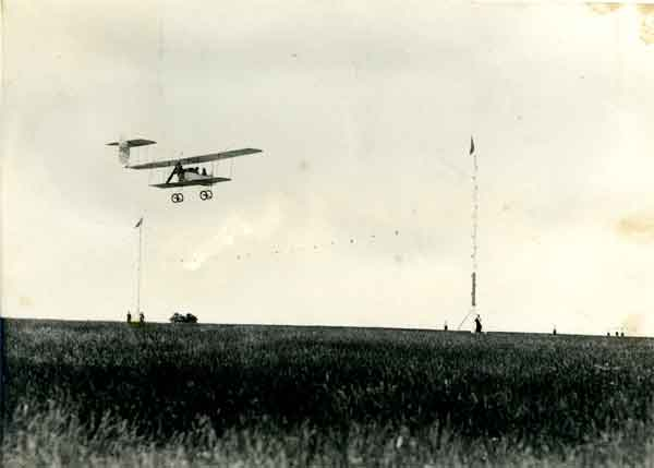 Lt George Carmichael practising short landings over an imaginary hedge represented by tape stretched between two poles. (B2192)