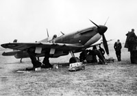 Refuelling and re-arming a Spitfire. As soon as aircraft returned from a sortie they were re-fuelled and re-armed ready for the next one. This constant activity placed a heavy strain on men and machines.
