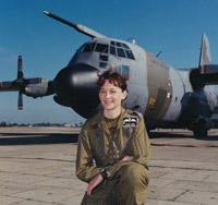 Flight Lieutenant Julie Gibson with a Lockheed Hercules