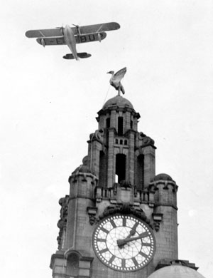 Flying over Liverpool, England while on Sir Alan Cobham's tour of Great Britain