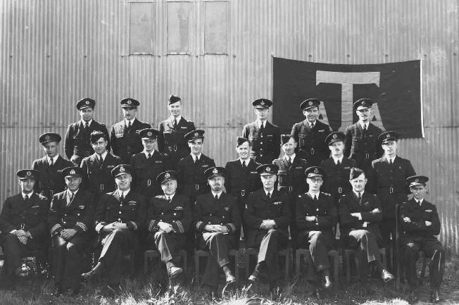 Group photograph of men in ATA uniform. 1941