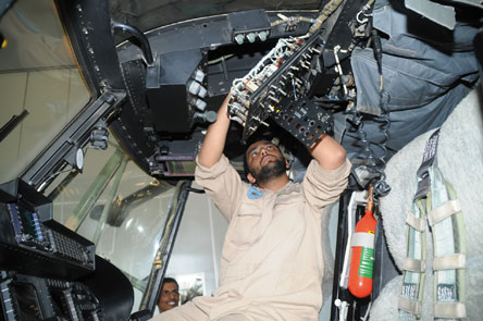 One of the Royal Air Force of Oman's highly skilled technicians working on a RAFO Helicopter