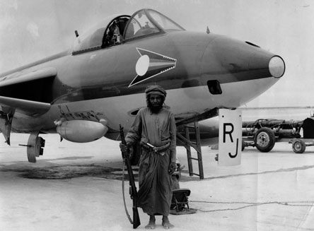 A Hawker Hunter FR10 flown by Fl Lt Richard Johns of No 1417 Flight at RAF Salalah in 1965. The aircraft is guarded by a local Omani, that the pilots nicknamed 'Elvis'